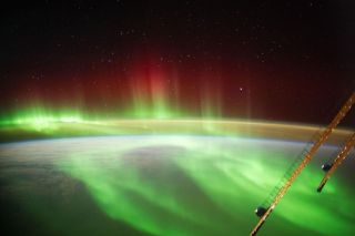 An aurora spotted from the International Space Station. An Oct. 11 geomagnetic solar storm created auroras that stretched as far south as New York.
