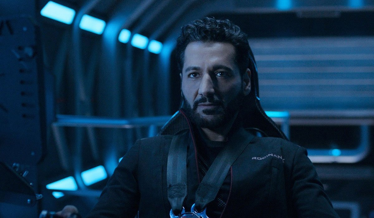 Cas Anvar buckled up in a spaceship.