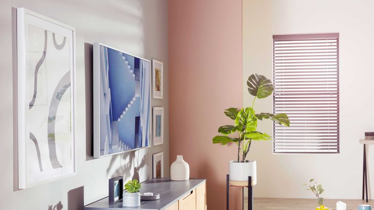 ways to hide your TV Pastel coloured living room showing a Samsung Frame TV that doubles up as artwork