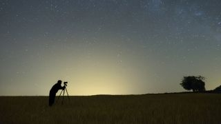 Astrophotography competitions: Image shows person taking photo of night sky