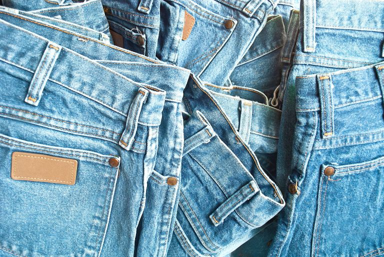 Pile of light denim jeans