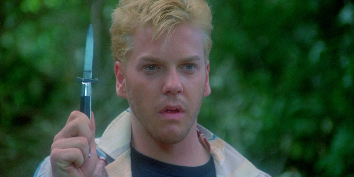 Kiefer Sutherland as Ace holding a knife in Stand By Me