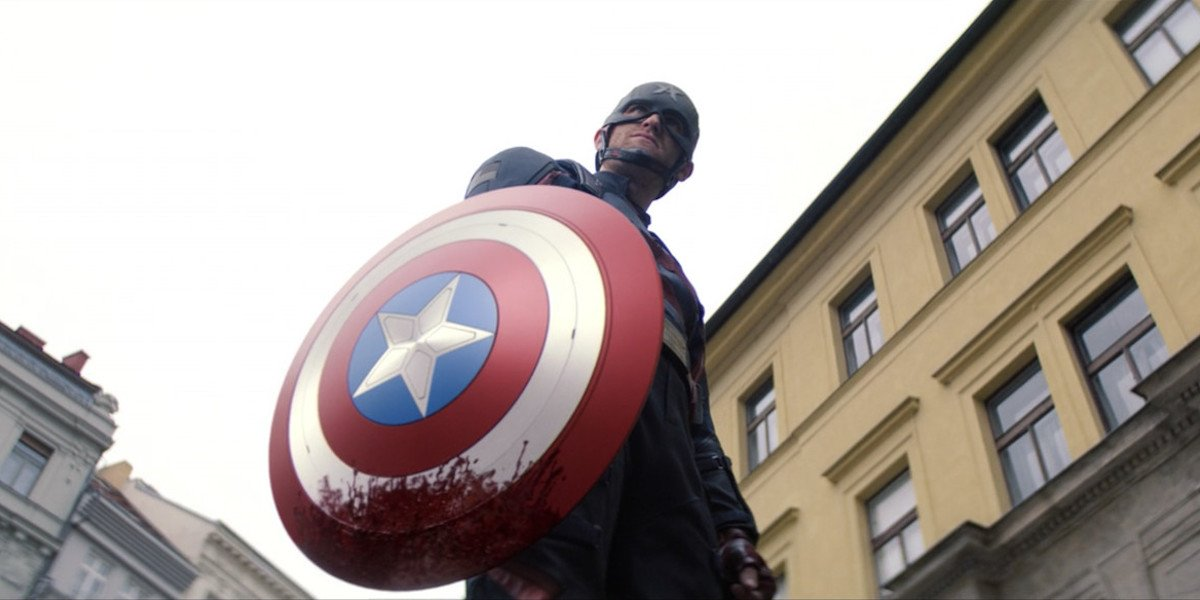 John Walker holding bloody shield in The Falcon and the Winter Soldier