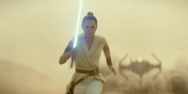 Rey running with lightsaber in Star Wars: The Rise of Skywalker