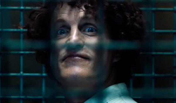 Venom Cletus Kasady smiles through his cell