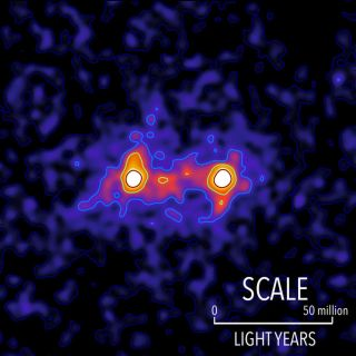 Dark matter filaments bridge the space between galaxies in this false color map. The locations of bright galaxies are shown by the white regions and the presence of a dark matter filament bridging the galaxies is shown in red.