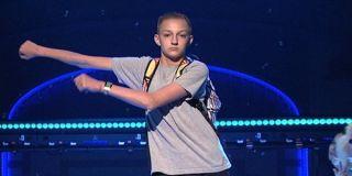 Backpack Kid performing floss dance