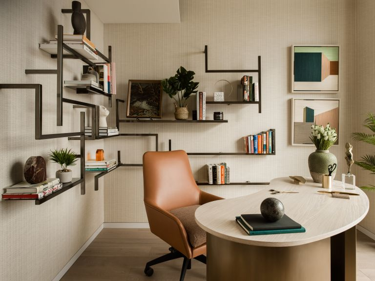 Home office setup with leather chair, curved desk and shelving