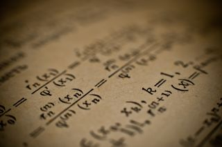 hazy mathematical formulas in a book