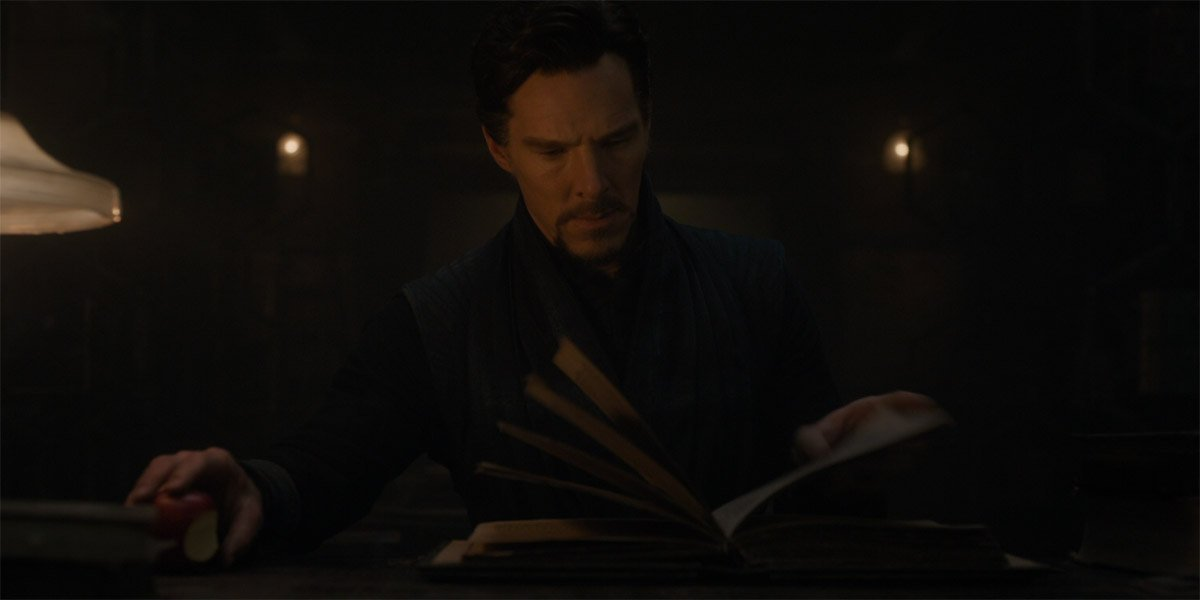 Doctor Strange (Benedict Cumberbatch) reads a spell book in Doctor Strange