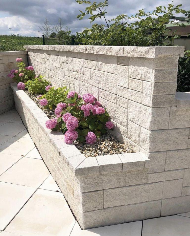 White stone garden wall ideas with planter