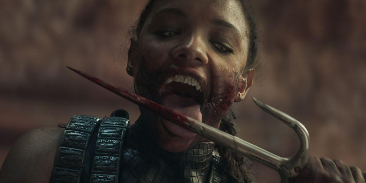Mortal Kombat licking blood off weapon.
