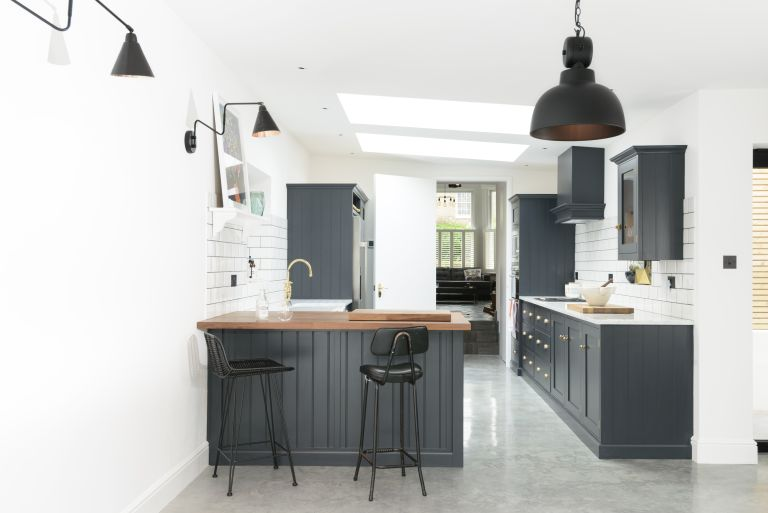 Extending for under £50,000: small black scheme kitchen in island with breakfast bar