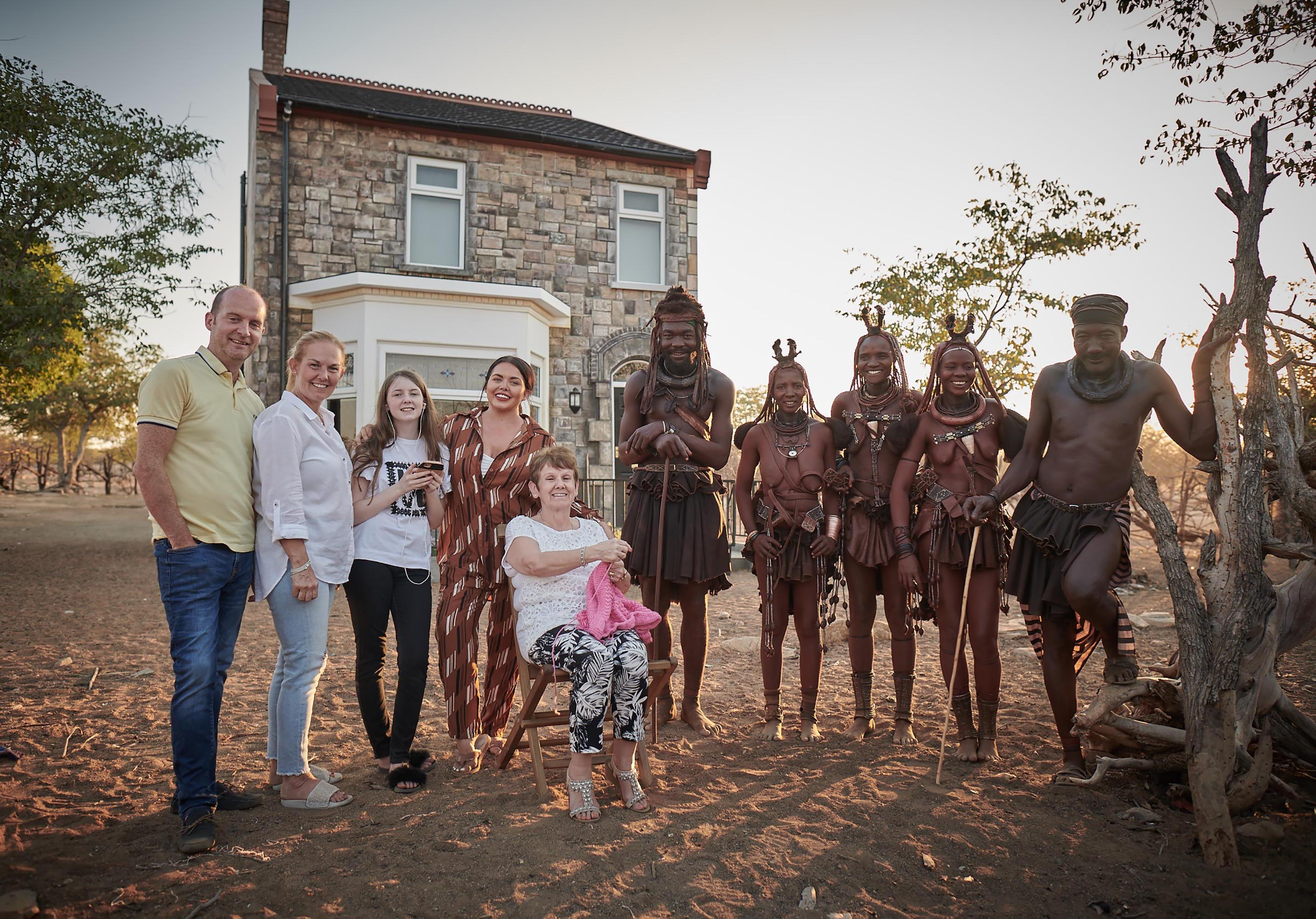 Scarlett Moffatt and family with Mboki, Muvii, Ueripanga, Kaitaarua and Kandisiko in front of their home-from-home in Namibia