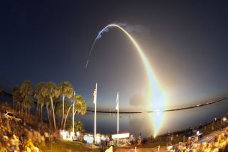 Image of the space shuttle Discovery launch from the Kennedy Space Center