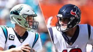 Sam Darnold #14 of the Carolina Panthers and Davis Mills #10 of the Houston Texans