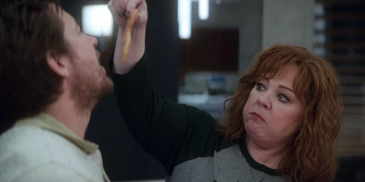 Melissa McCarthy feeding Jason Bateman raw chicken in Netflix's Thunder Force