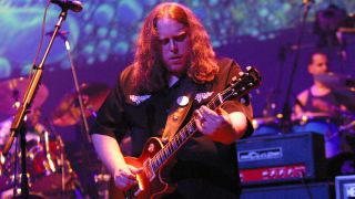 Warren Haynes playing guitar onstage