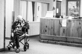 Elderly man in a wheel chair, cancer affects elderly people