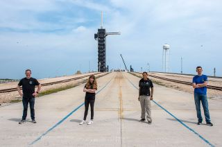 Chris Sembroski, Hayley Arceneaux, Sian Proctor and Jared Isaacman pose in front of their SpaceX launch pad, Complex 39A at NASA's Kennedy Space Center in Florida on Monday, March 29, 2021.
