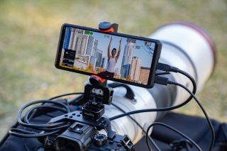 Sony Xperia Pro attached via a Manfrotto clip and SmallRig to a Sony Alpha camera