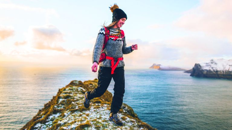 Woman on a mountaintop wearing Merrell Zion Gore-Tex Mid hikers
