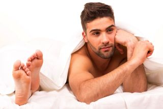 Man said in bed with woman's feet