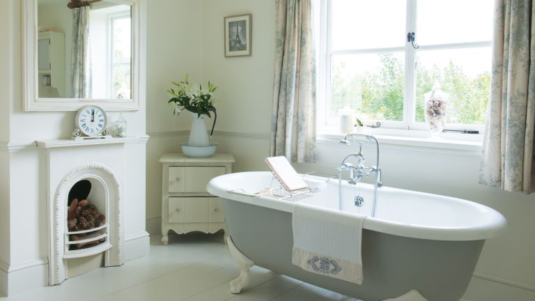 Roll top bath in traditional bathroom