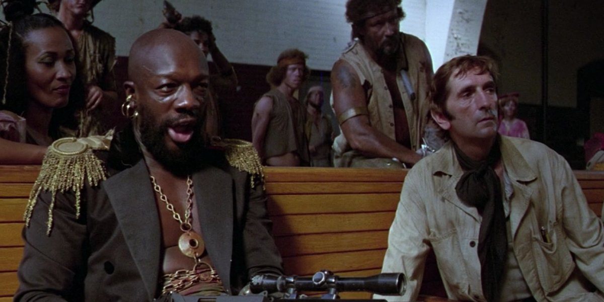 Isaac Hayes and Harry Dean Stanton in Escape From New York