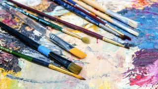 best paintbrushes for oils - some paintbrushes on a palette