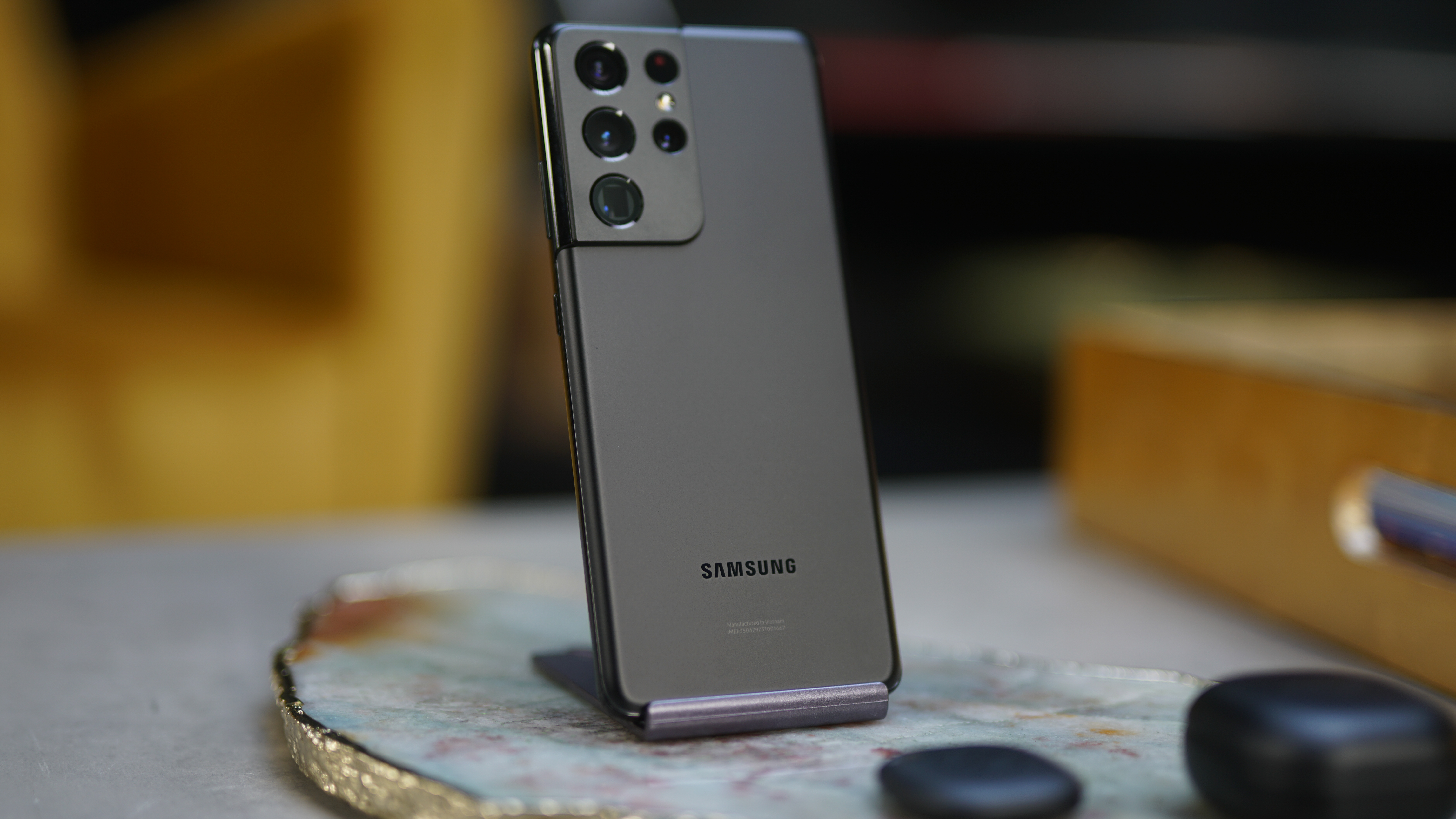 A Samsung Galaxy S21 Ultra from the back in a plain shade