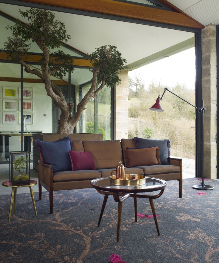 Patterned carpet in living room by Brintons