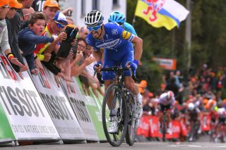 Deceuninck-QuickStep's Julian Alaphilippe gets the better of Jakob Fuglsang (Astana) and UAE Team Emirates' Diego Ulissi to win the 2019 Flèche Wallonne