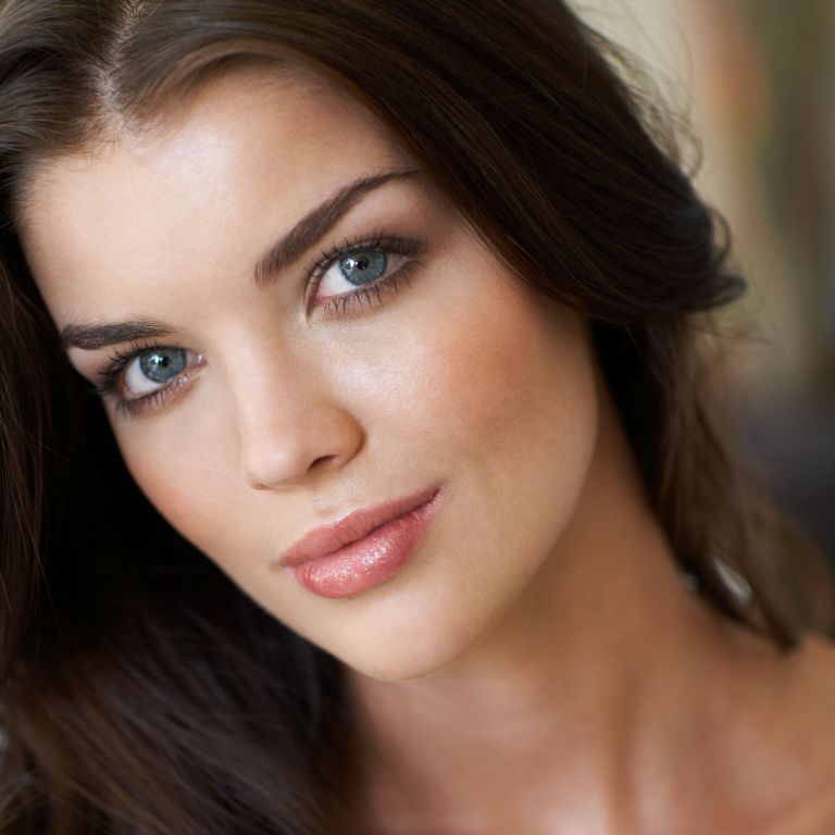 Photo of a model with dark hair and natural make-up