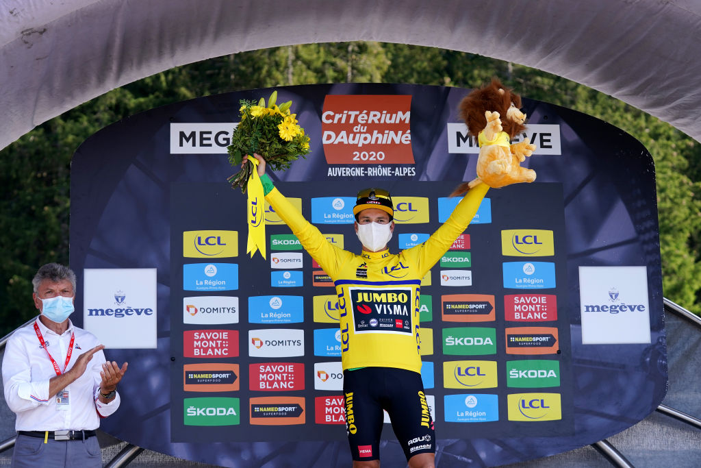 MEGEVE FRANCE AUGUST 15 Podium Primoz Roglic of Slovenia and Team Jumbo Visma Yellow Leader Jersey Celebration Covid safety measures Flowers Mascot during the 72nd Criterium du Dauphine 2020 Stage 4 a 1533km stage from Ugine to Megeve 1458m dauphine Dauphin on August 15 2020 in Megeve France Photo by Eddy LemaistrePool via Getty Images