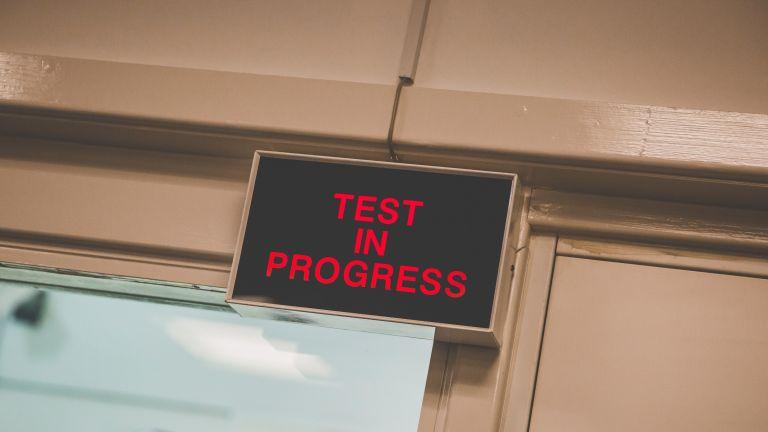 test in progress sign outside windtunnel