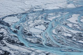 Each summer, large rivers emerge on the surface of Greenland, swiftly sending meltwater from the ice sheet into the sea.