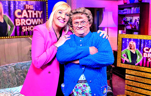 Cathy with Mrs Brown. All Round to Mrs Brown's is on Saturday 26th May