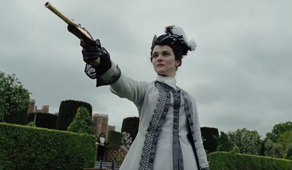 The Favourite Rachel Weisz aims a dueling pistol with malicious intent