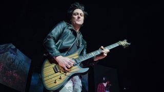 Synyster Gates playing guitar