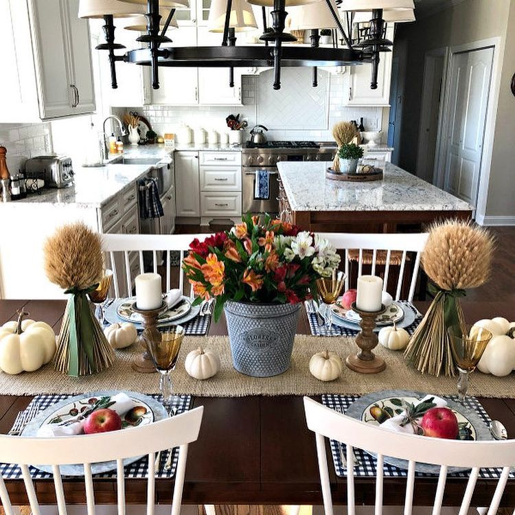 Country kitchen diner with wrought iron chandelier