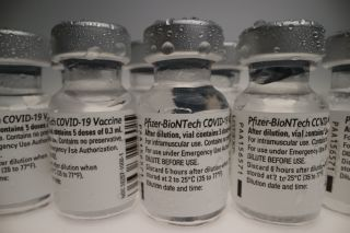 Vials of Pfizer-BioNTech COVID-19 vaccine lined up.