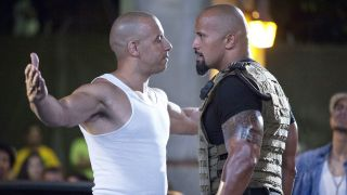 Vin Diesel and Dwayne Johnson in each other's faces in Fast Five