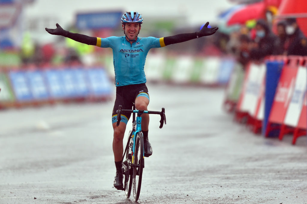 Team Astana rider Spains Ion Izagirre celebrates as he crosses the finishline of the 6th stage of the 2020 La Vuelta cycling tour of Spain a 1464 km race from Biescas to Formigal on October 25 2020 Photo by ANDER GILLENEA AFP Photo by ANDER GILLENEAAFP via Getty Images