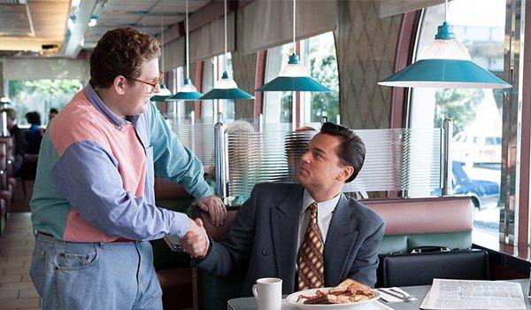 Jonah Hill's Character Donnie Azoff meets Jordan Belfort, played by Leonardo DiCaprio