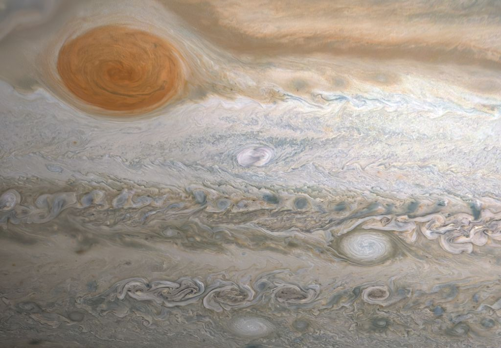 Jupiter's Great Red Spot may survive by gobbling up smaller storms