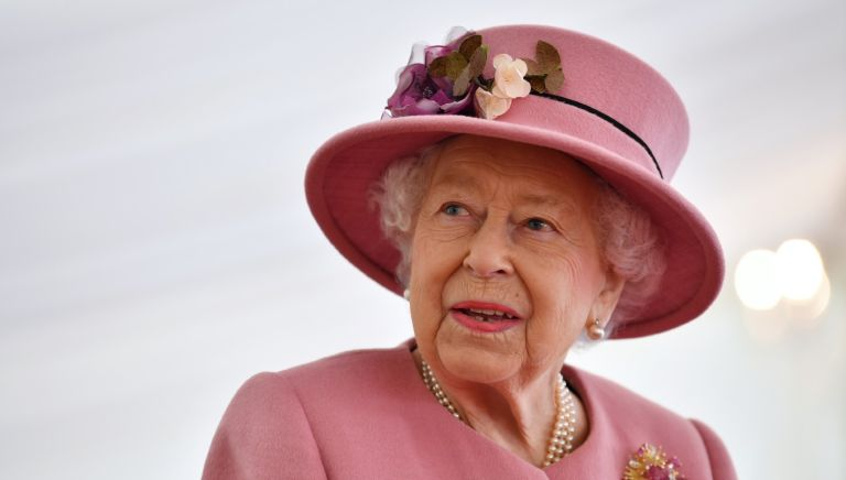 The Queen speaks with staff during a visit to the Defence Science and Technology Laboratory (Dstl) at Porton Down science park on October 15, 2020 near Salisbury, England.