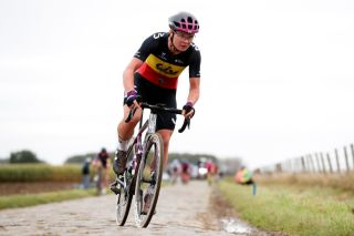 Lotte Kopecky (Liv Racing) chases after a puncture in Paris-Roubaix