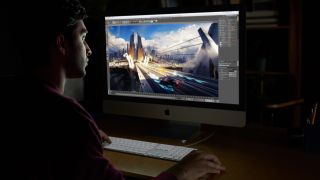 Person editing video footage on an iMac Pro