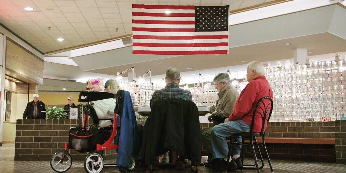Residents of Jasper, Alabama, play dominios in Jasper Mall